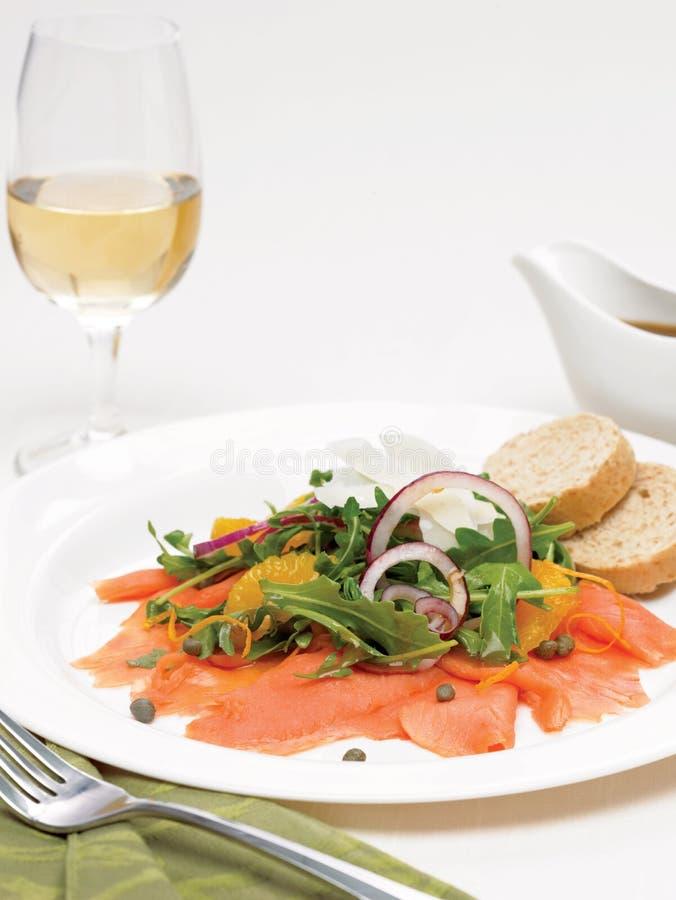 Smoke salmon arugula and orange salad royalty free stock photo