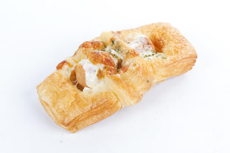 Smoke sausage Danish pastries. On the white background royalty free stock photo