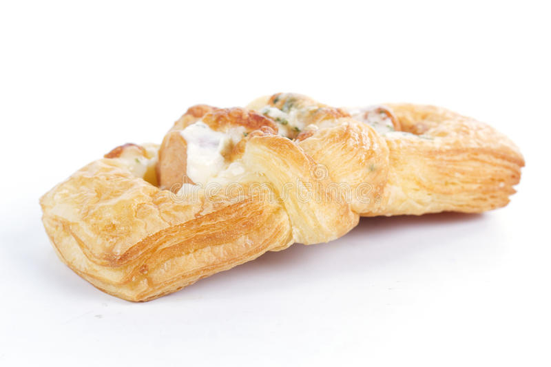 Smoke sausage Danish pastries. On the white background royalty free stock photography
