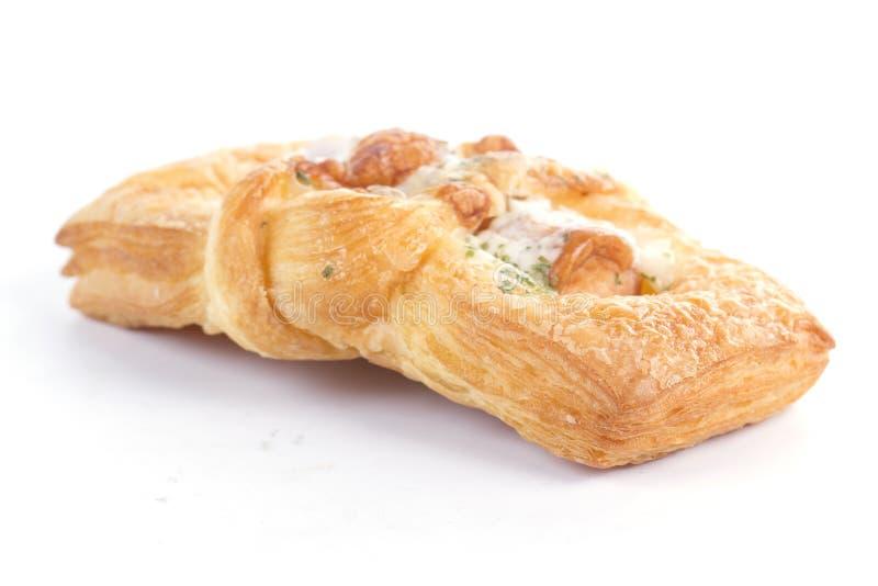 Smoke sausage Danish pastries. On the white background royalty free stock image