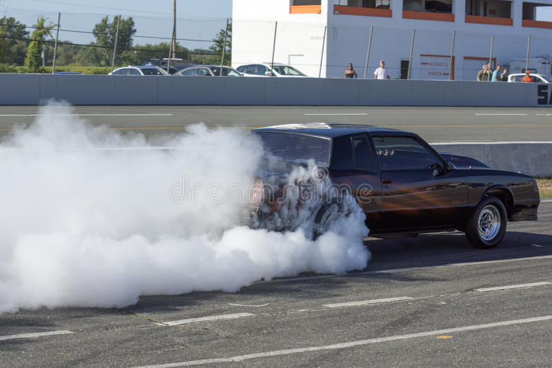 Smoke show exhibition. Picture of chevrolet monte carlo during burnout at the grand national show at sanair, quebec, canada august 17-18 2013 stock photography