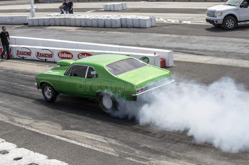 Smoke show on the track. Picture of chevrolet nova making a smoke show at the starting line on the track during the festidrag event at napierville dragway stock photography