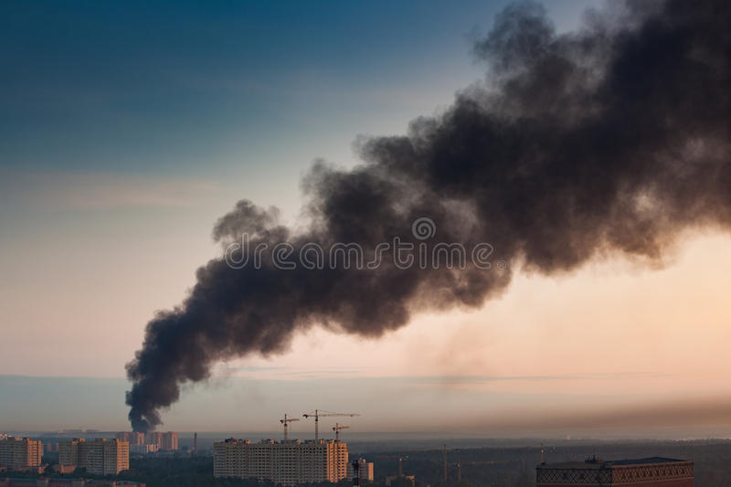 Smoke at sky. Of morning city. Big fire at apartment house stock images