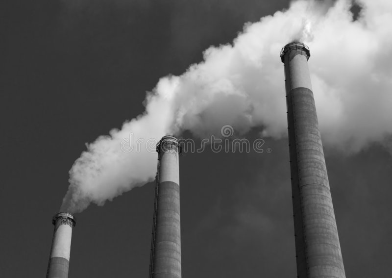 Smoke Stack. S spewing Vapor into the Air royalty free stock photography