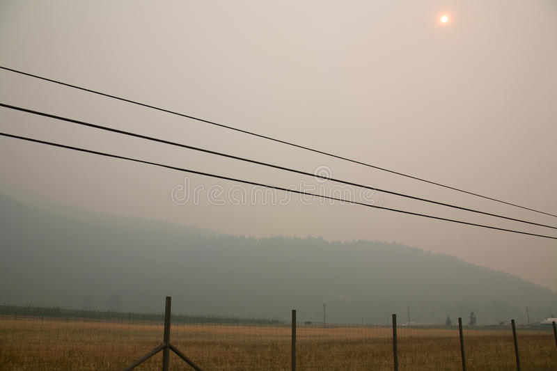Smoke from Stickpin Fire. Smoke from the Stickpin forest fire in Washington State, USA, fire pouring into Grand Forks British Columbia Canada stock photo