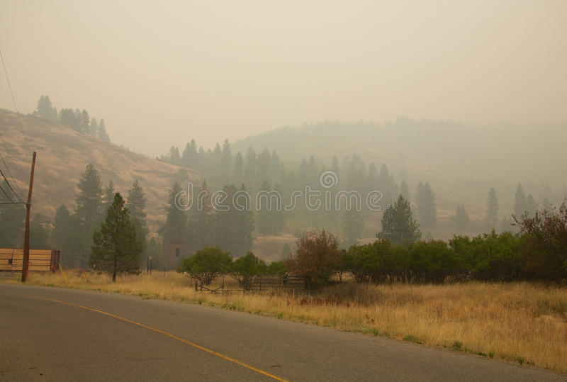 Smoke from Stickpin Fire. Smoke from the Stickpin forest fire in Washington State, USA, fire pouring into Grand Forks British Columbia Canada stock image