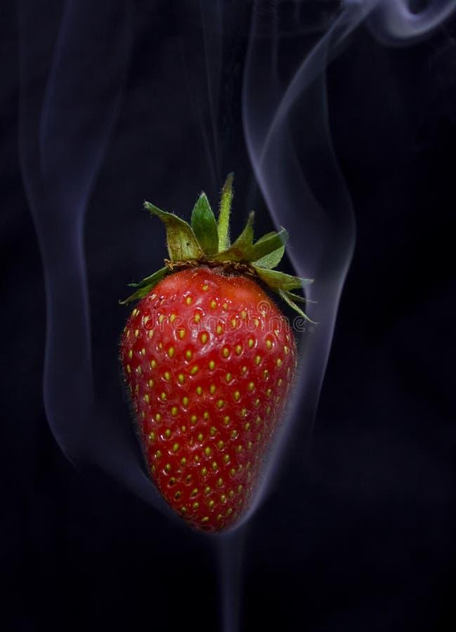 Smoke strawberry stock image