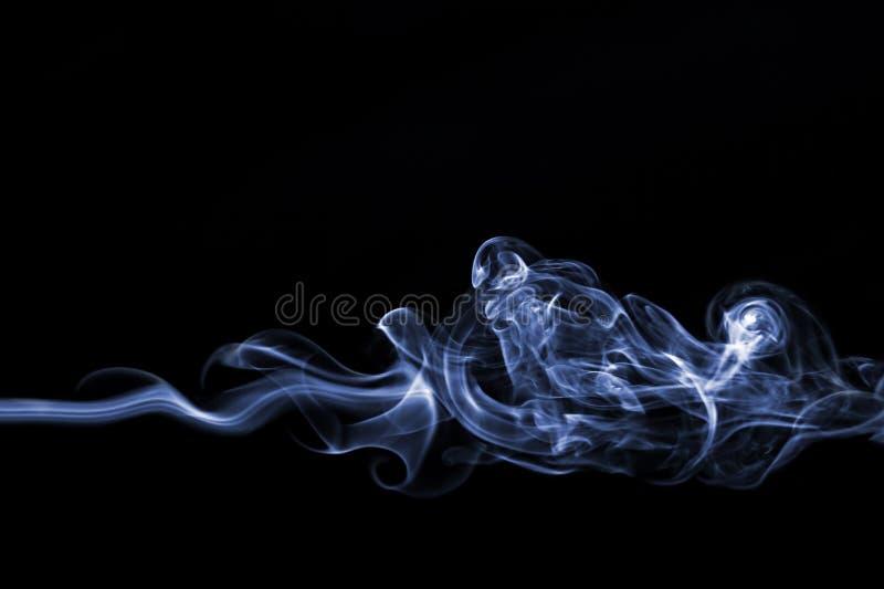 Smoke swirl. On black background stock photography