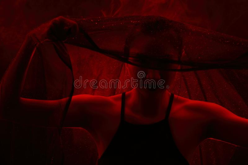 Smoke Tan Skin Asian Woman black hair dark lip with Dense Fluffy. Puffs of White Smoke and Fog on dark Background, Abstract Smoke girl mysterious Clouds, and royalty free stock image