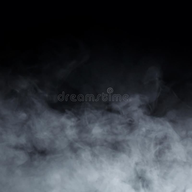 Abstract smoke texture over black background stock photos