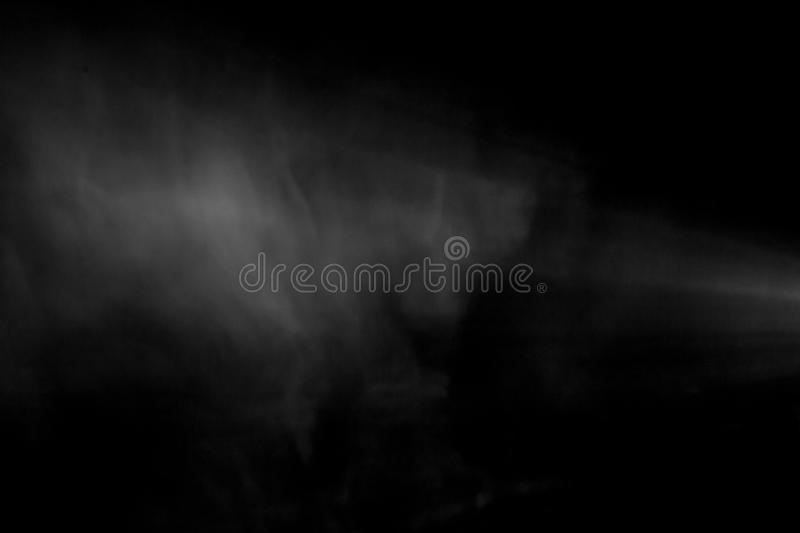 Smoke texture or pattern in the air , bright light effect realistic at dark background . royalty free stock photos