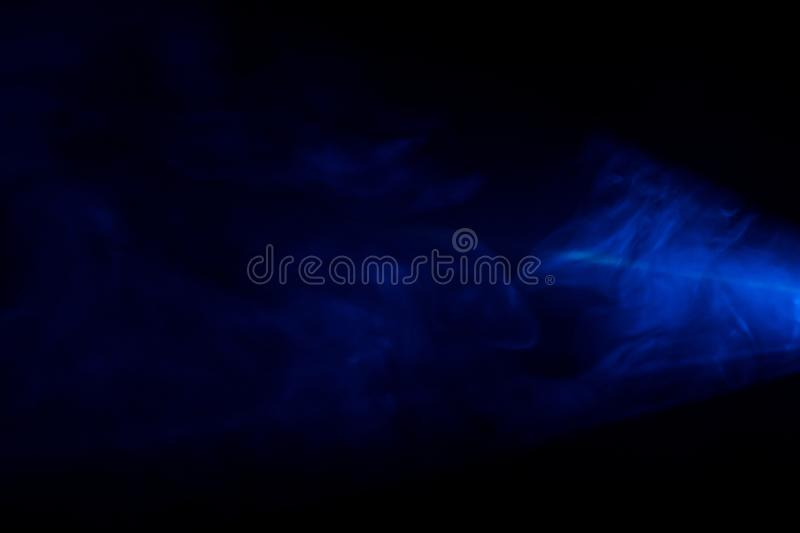 Smoke texture or pattern in the air , bright light effect realistic at dark background . royalty free stock photography