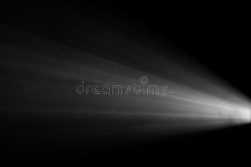 Black and white color . projector beautiful spotlight . wide lens equipment for show presentation . smoke abstract background . stock photography