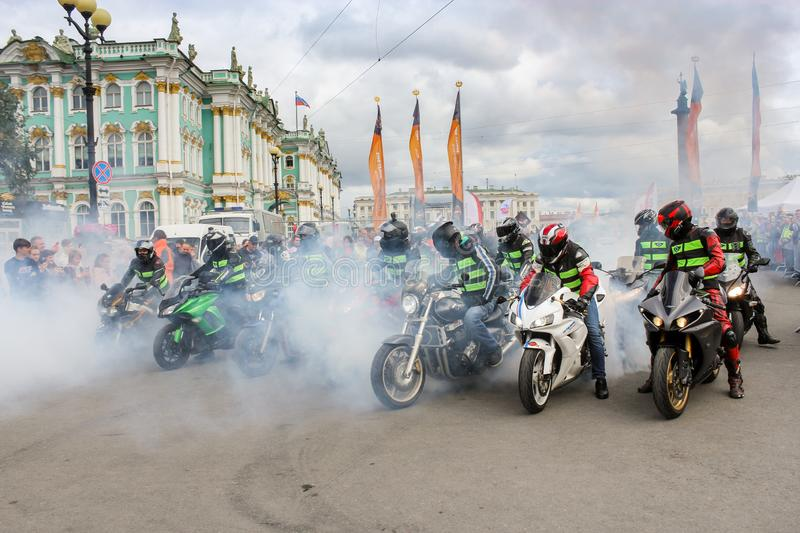 Smoke from the wheels of motorcycles stock photos