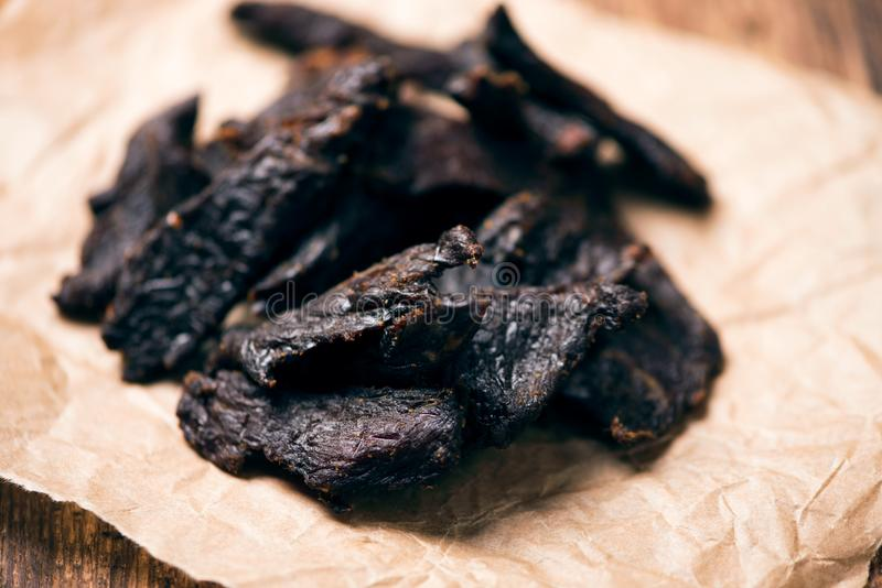 Smoked beef jerky on on a table stock photography