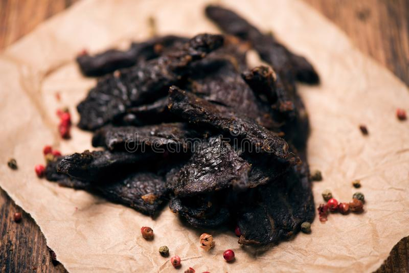 Smoked beef jerky on on a table royalty free stock image