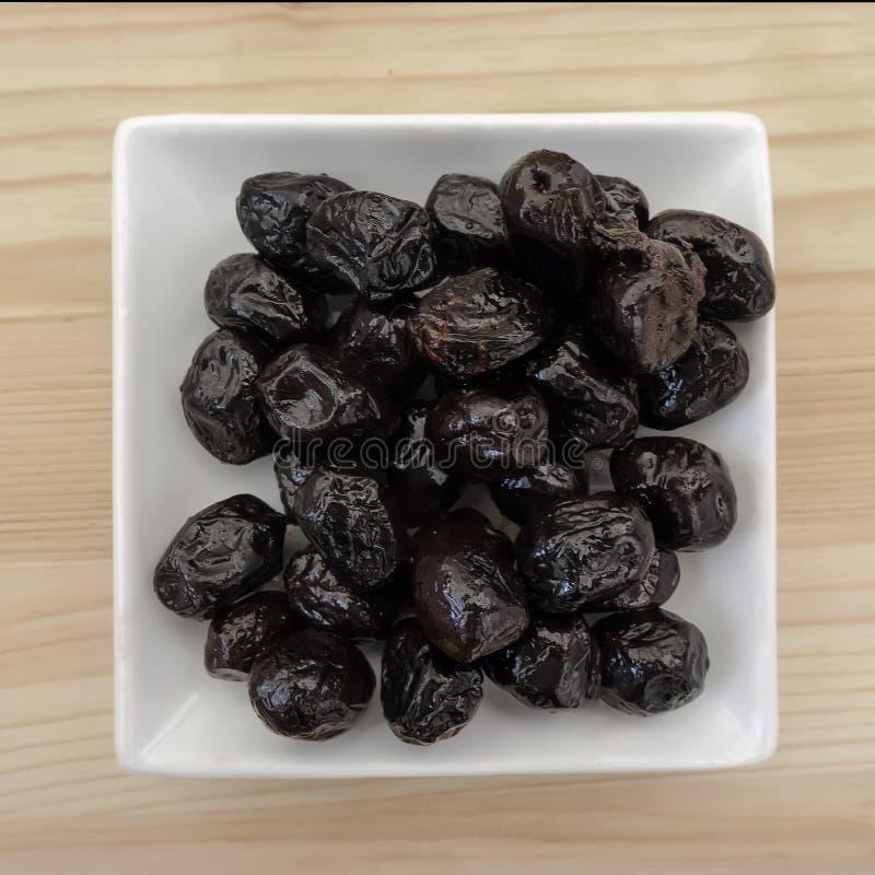 Smoked black olives stock photography