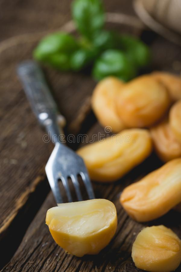 Smoked cheese and fresh basil. Smoked Cheese Slices with Fresh Basil royalty free stock photography