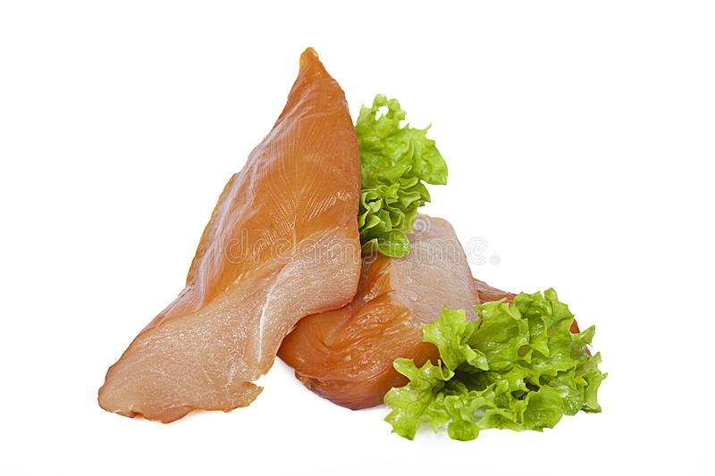 Smoked chicken breast with lettuce leaves. Isolated on white background stock images