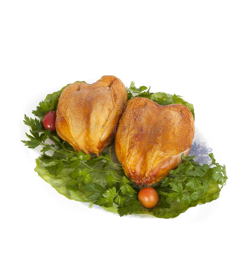 Smoked chicken breast on lettuce leaves. stock image
