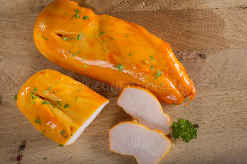 Smoked chicken fillets stock photography