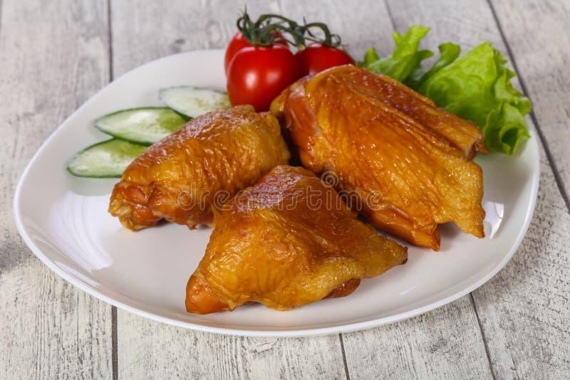 Smoked Chicken hip stock photo