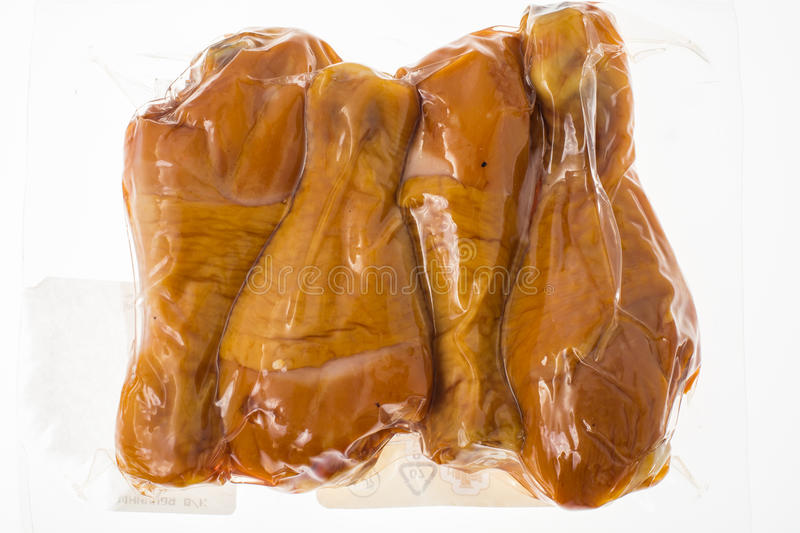 Smoked chicken in vacuum plastic packaging stock photography