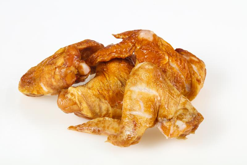 Smoked chicken wings over white background stock images