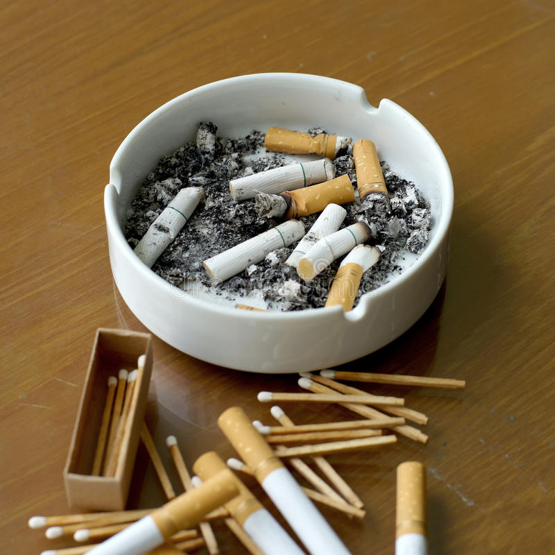Free Smoked Cigarettes In White Ashtray And Matchstick Royalty Free Stock Image - 74212256