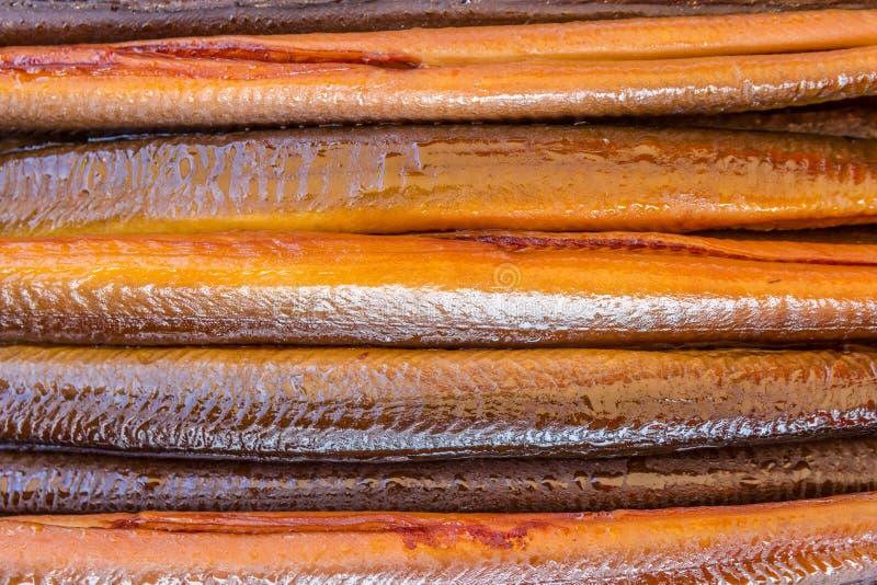 Smoked eels closeup. Prepared and smoked eels closeup stock images