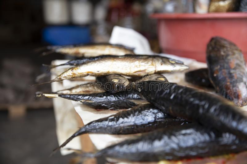 Smoked Fish from Ghana Market. For food. This is how they usually arranged for sale stock images