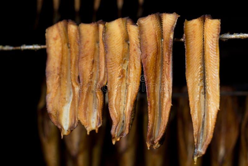 Smoked fish - herring royalty free stock images