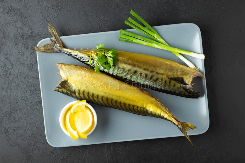 Smoked fish mackerel or scomber on a rectangular plate. royalty free stock images