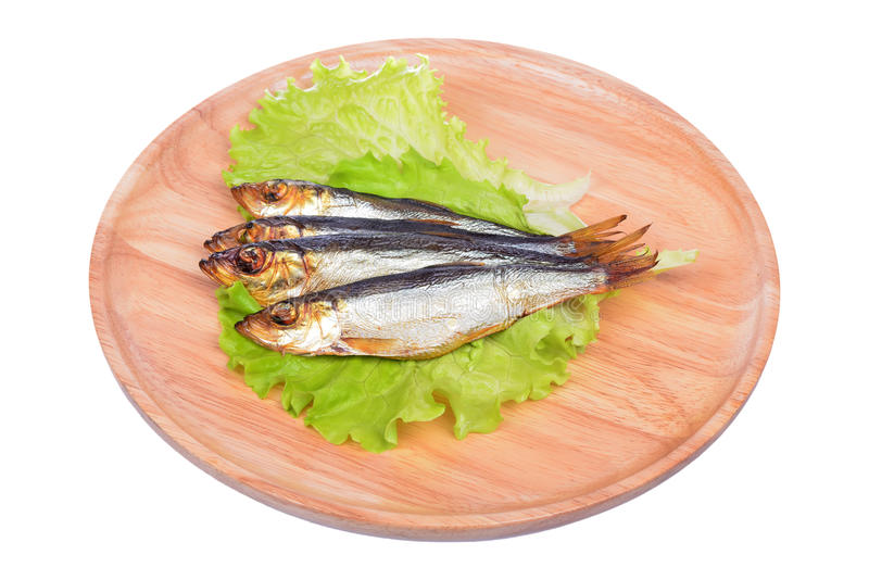 Smoked fish and salad on a wooden board isolated on white royalty free stock photos