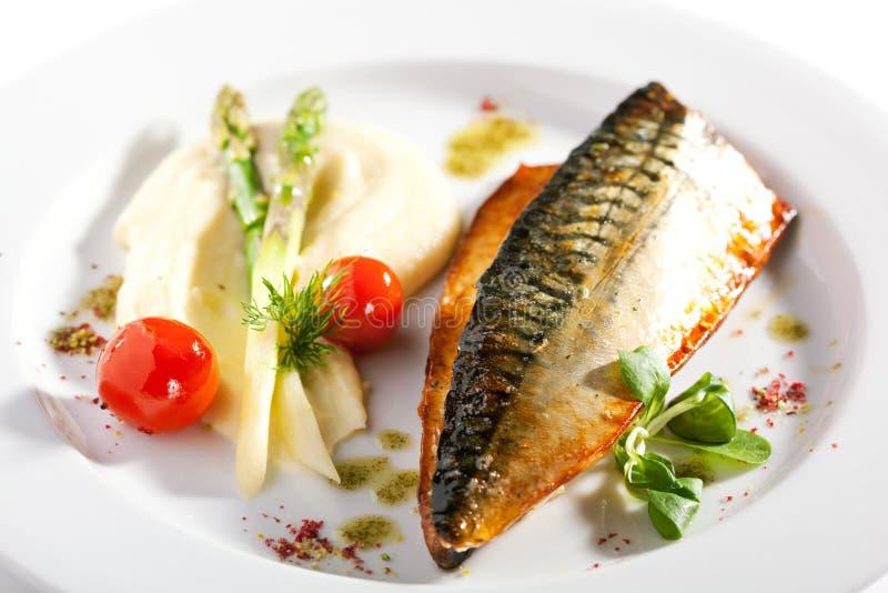 Smoked Fish with Vegetable Garnish stock image
