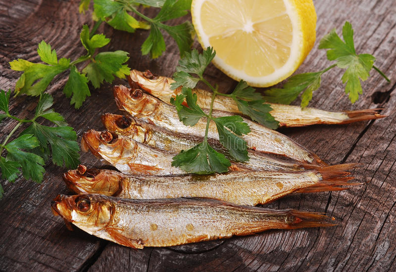 Smoked Fishes With Herbs Stock Image