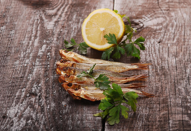 Download Smoked fishes with herbs stock photo. Image of herring - 28021866