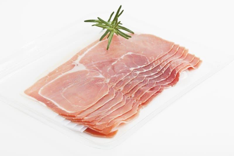 Smoked ham. Some pieces of smoked ham on white background stock image