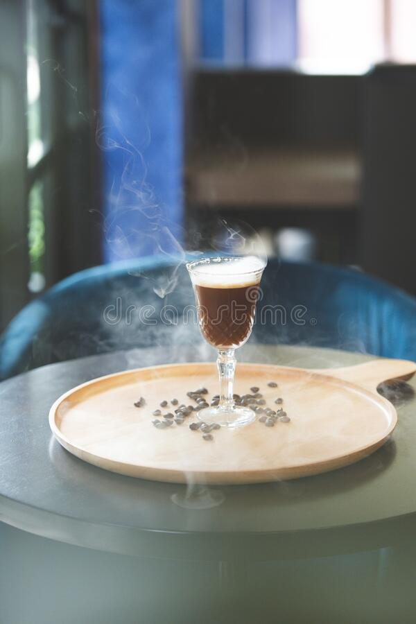 Smoked light roasted coffee with a hint of orange peel. stock photography