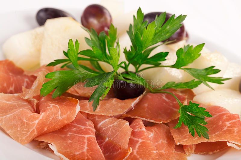 Smoked meat beef slices with and vine pieces stock photos
