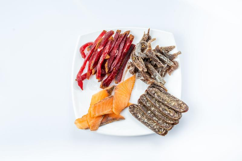 Smoked meat to beer. venison, meat sausage, salted red fish. beer kit. Meat dish stock photo