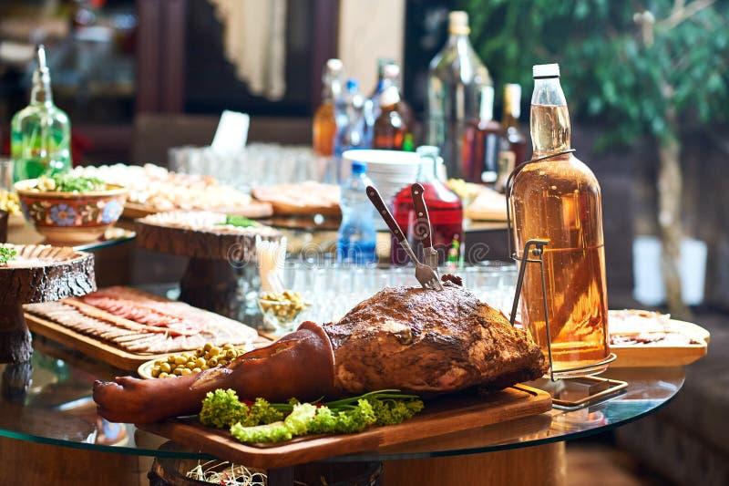 Smoked pork leg on the restaurant table royalty free stock photo