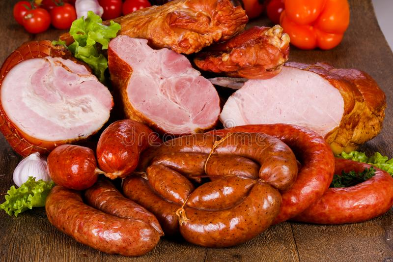 Smoked pork meat. Over wooden background royalty free stock photo