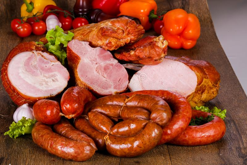 Smoked pork meat. Over wooden background stock images
