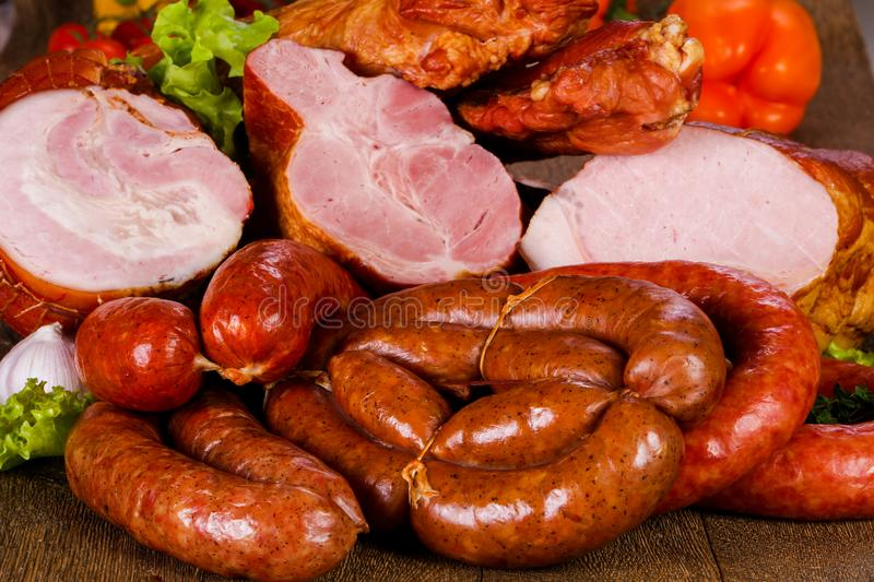 Smoked pork meat. Over wooden background stock photography