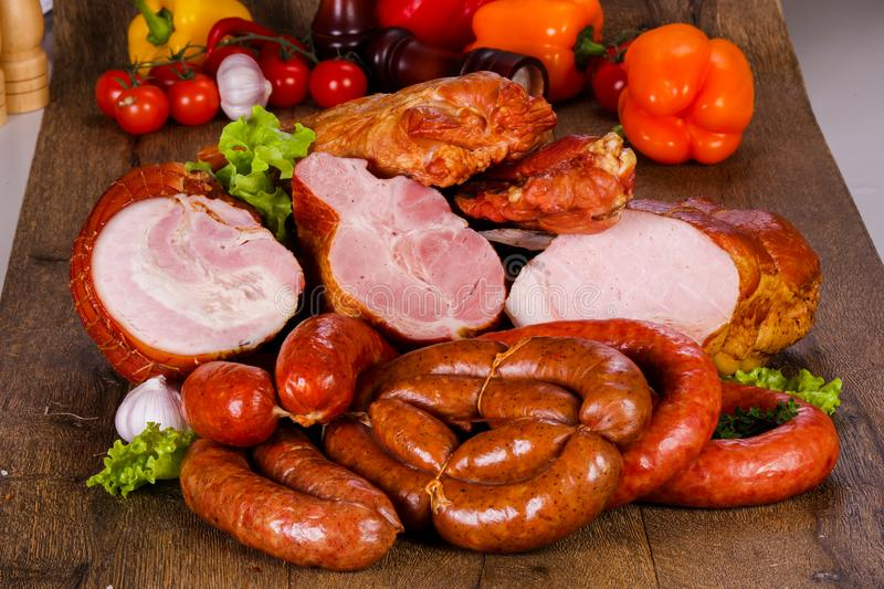 Smoked pork meat. Over wooden background stock photos