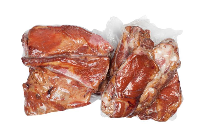 Smoked pork meat in vacuum package. Isolated on white background royalty free stock photos