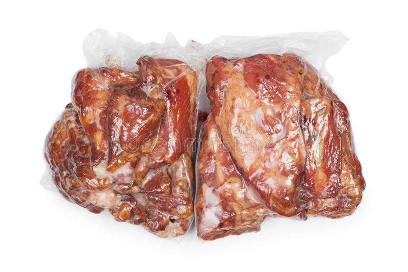 Smoked pork meat in vacuum package. Isolated on white background royalty free stock photography