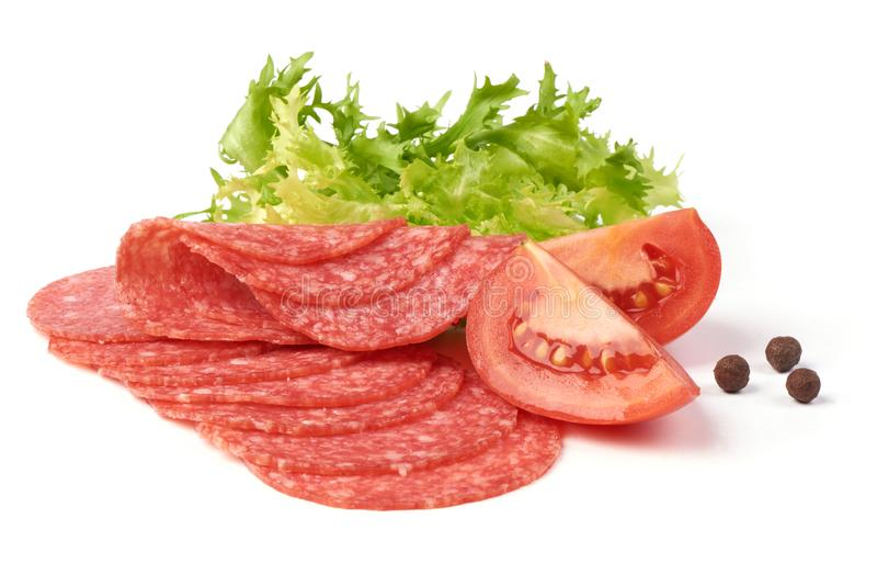 Smoked salami with green lettuce, tomatoes and spices, isolated on the white background.  stock photo