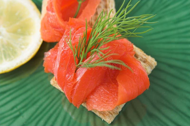Smoked salmon appetizer stock photography